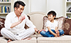 man and child on sofa